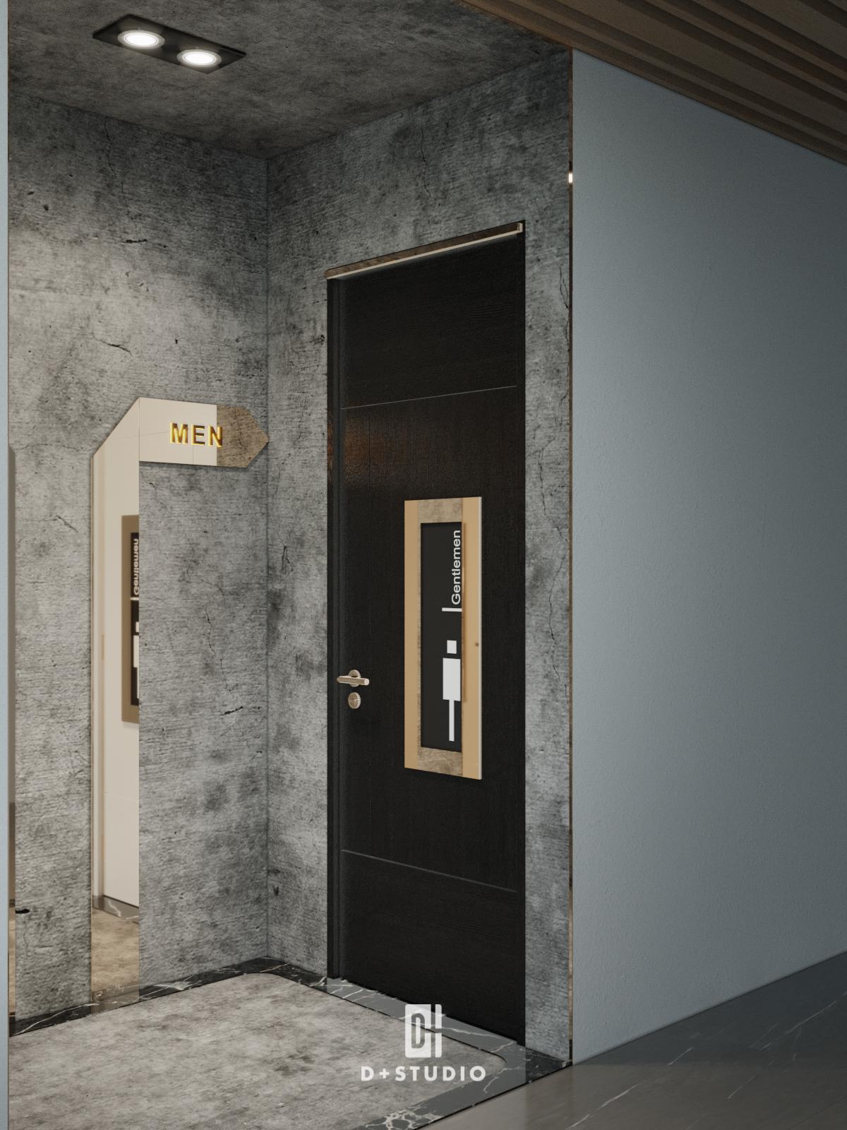 Cửa màu đen kết hợp tông màu xám trên tường đem lại cảm giác sạch sẽ cho khu vệ sinh đồng thời hài hòa với tổng thể thiết kế văn phòng sang trọng, chuyên nghiệp