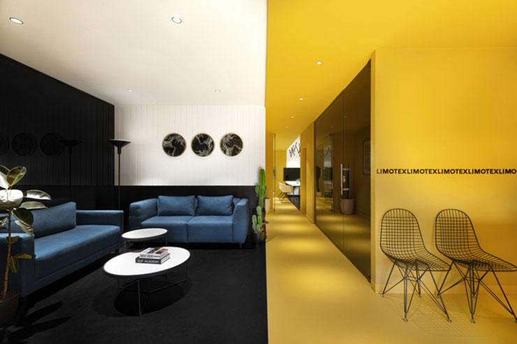 Không gian văn phòng như được chia làm đôi: Sự sang trọng ở phòng chờ với màu đen - trắng xanh; sự năng động, tươi vui ở phòng làm việc tông màu vàng tươi