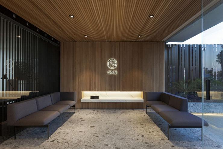 Khu vực phòng chờ sử dụng các vật liệu như gỗ, kính, đá mang lại cảm giác sang trọng, ấm cúng và thoáng đãng